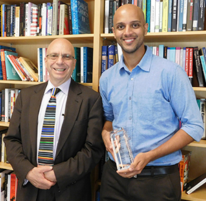 Ian Shapiro presented Tariq Thachil, right, with the Gaddis Smith International Book Prize for best first book.