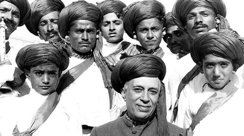 Pandit Jawaharlal Nehru with folk dancers from Bombay at a Republic Day Parade. (Photo: Express archive)